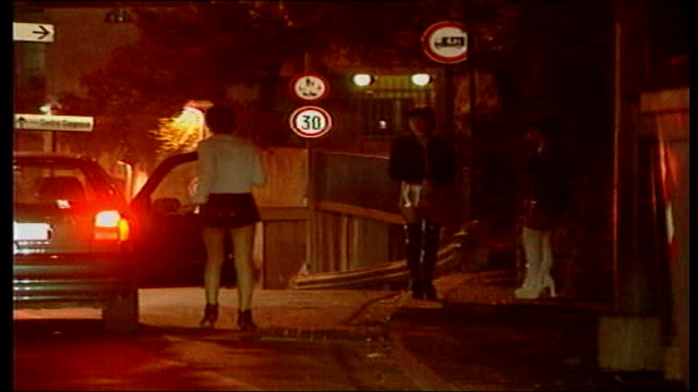 vídeos de stock, filmes e b-roll de nationwide police operation set up to stop it tx two prostitutes in high boots and short skirts on street corner as third prostitute in similar dress... - prostituta