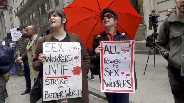 sex workers. new york city - wall street, international workers day . footage by tomas abad/getty images). - 売春者点の映像素材/bロール