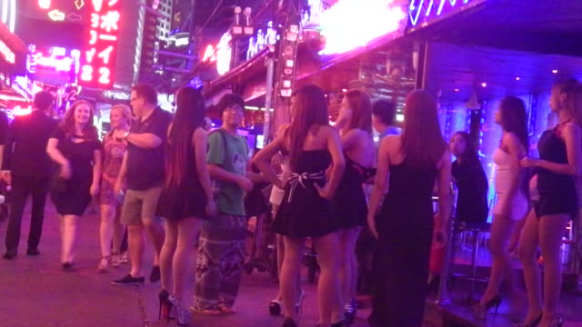 sex workers talk to people on soi cowboy bangkok on the day the government relaxed mourning restrictions the king of thailand died october 13 and the... - nutten stock-videos und b-roll-filmmaterial