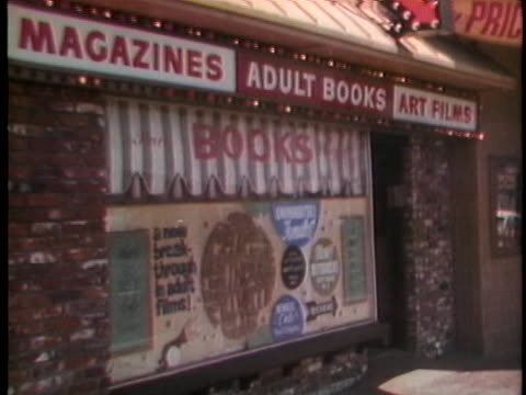 sexually explicit signs advertise pornography and x-rated adult entertainment in los angeles as the u.s. supreme court investigates obscenity issues. - signierstunde stock-videos und b-roll-filmmaterial