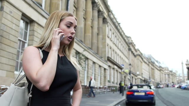 sexy attractive good looking young blonde woman in black dress angry on mobile phone cell call london street - black dress stock videos & royalty-free footage