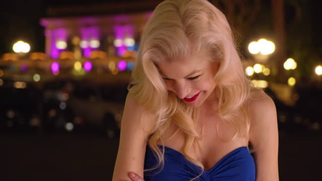 sexy blonde female in a dress blowing kiss to camera - lipstick kiss stock videos and b-roll footage