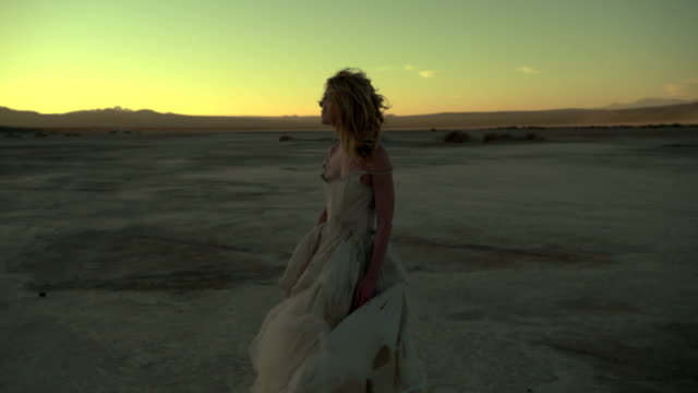 (slow motion) sexy blonde in the desert 04 - fashion model stock videos and b-roll footage
