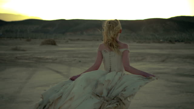 (slow motion) sexy blonde in the desert 06 - haute couture stock videos and b-roll footage