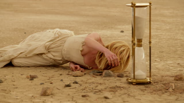 (slow motion) sexy blonde in the desert 08 - haute couture stock videos and b-roll footage