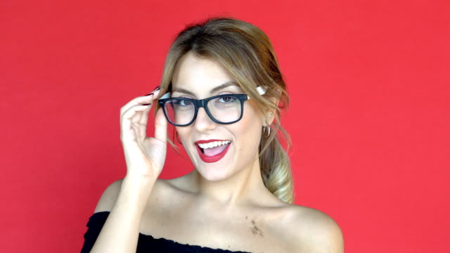 sexy blonde taking of eyeglasses and sending warm kisses.facial expressions - decollare attività video stock e b–roll