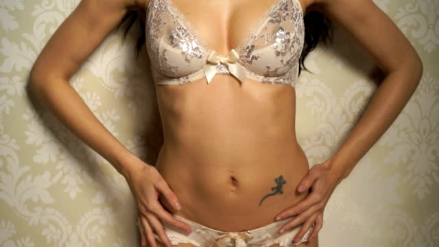 sexy brunette on vintage wallpaper - bra stock videos & royalty-free footage
