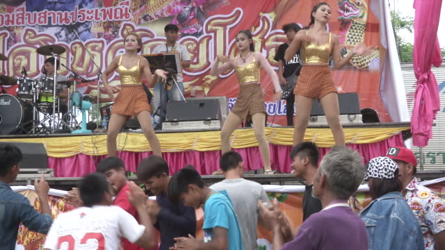Sexy dancers perform on stage during the Ban Bung Fai Rocket Festival in Yasothon Thailand