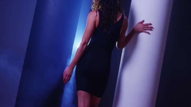 sexy ethnic woman in little black dress walking - black dress stock videos & royalty-free footage