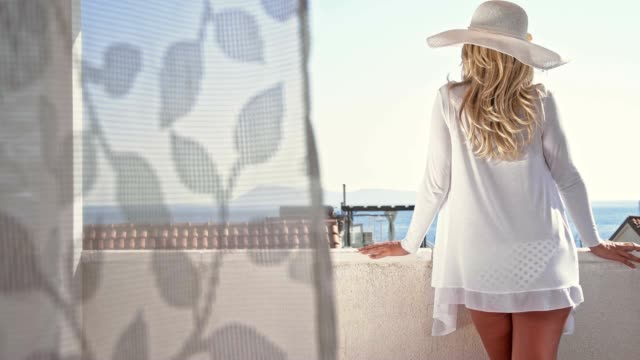 slo mo sexy fashionable woman relaxing on the balcony - white shirt stock videos & royalty-free footage