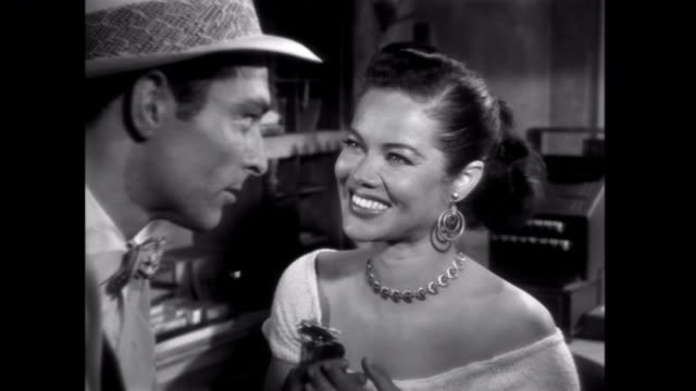 1952 A sexy saleswoman manipulates a gangster into buying her a bottle of expensive perfume