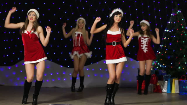 sexy santa girl's holding and dancing with 2010 silver balloon's - seductive women stock videos & royalty-free footage