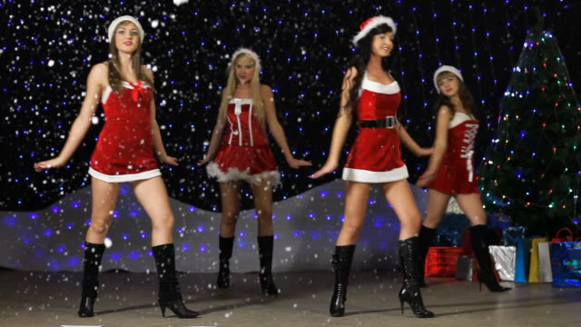 sexy santa helper's dancing and showing number 2010 - fake snow stock videos & royalty-free footage