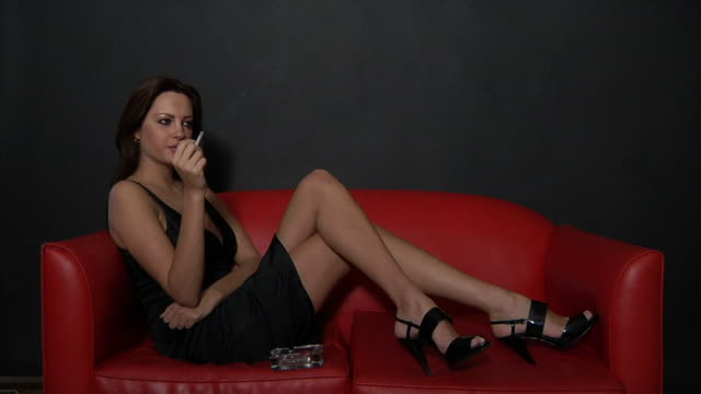 sexy smoking - cross legged stock videos & royalty-free footage