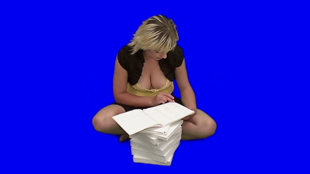 Sexy student girl with heap of workbooks