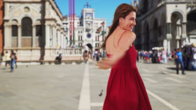 sexy white brunette dancing around at st. mark's square in venice, italy - red dress stock videos & royalty-free footage