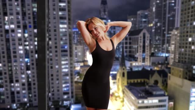 sexy woman dancing in little black dress - black dress stock videos & royalty-free footage