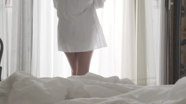 hd dolly: sexy woman going on a balcony - bedroom stock videos & royalty-free footage