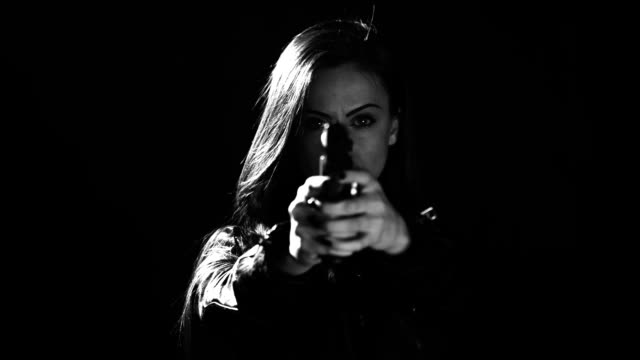 sexy woman holding gun - femme fatale stock videos and b-roll footage