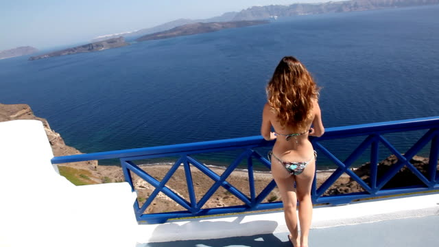sexy woman infront of a beautiful scenery - santorini stock videos and b-roll footage