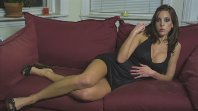 HD CRANE: Sexy woman seducing from the sofa