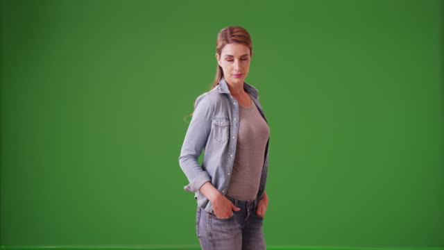 sexy woman standing waiting for a cab on green screen - car chroma key stock videos & royalty-free footage