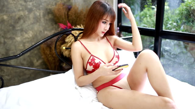 Sexy woman using mobile phone