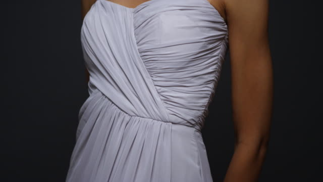 sexy woman wearing white gown looking at camera - evening gown stock videos & royalty-free footage