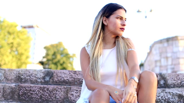 Sexy woman with ombre colored hair posing