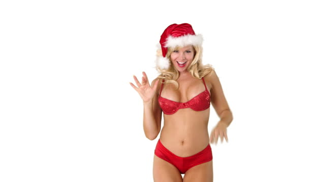 sexy young girl in santa hat blowing kisses - santa hat stock videos and b-roll footage