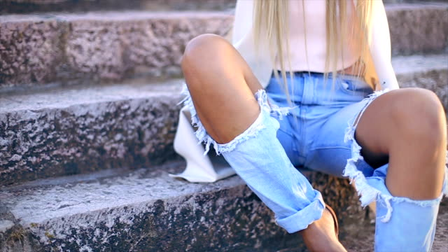 sexy young stylish hipster woman posing - baggy jeans stock videos & royalty-free footage