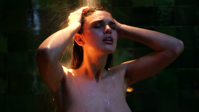 CU Sexy young woman taking bath under shower