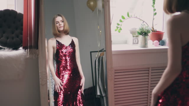 sexy young woman trying on red sequin dress - dress stock videos and b-roll footage