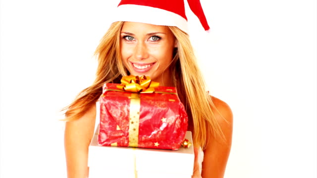 Sexy young woman with christmas gifts