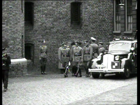 seyssinquart arrives by car at the binnenhof and inspects the german troops who are lined up in square formation - binnenhof stock videos and b-roll footage