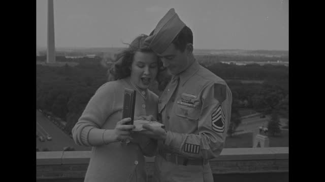 VS Sgt Jake Lindsey and girlfriend Beverly Hargreaves stand on rooftop wind blows their hair as they look at his newly received Congressional Medal...