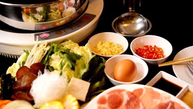 shabu shabu and sukiyaki,japanese style and thai style - sukiyaki stock videos and b-roll footage