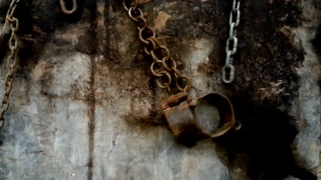 shackles and chains hanging on a wall