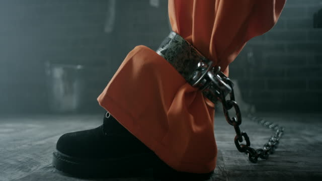 shackles on legs of inmate - human foot stock videos & royalty-free footage