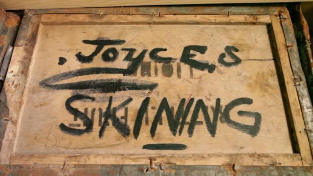 shackleton's hut interior - box with joyce's skinning written on top, ross island, antarctica  - western script stock videos & royalty-free footage