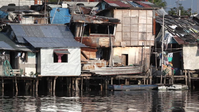 hd shacks along pasig river philippines - slum stock videos & royalty-free footage