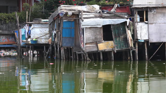 hd shacks along polluted river - water pollution stock videos & royalty-free footage
