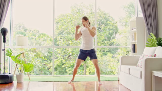 shadow boxing at home is fun. - exercise room stock videos & royalty-free footage