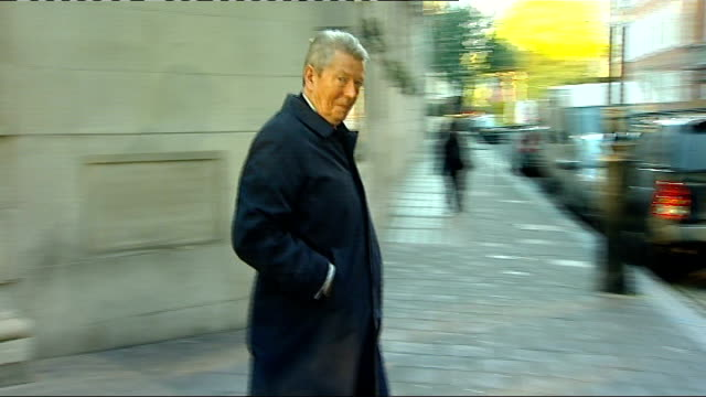 shadow chancellor alan johnson resigns r21101004 ext johnson departing building and across road johnson walking towards under scaffolding - alan johnson stock videos & royalty-free footage