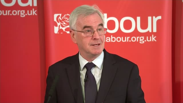 Shadow Chancellor John McDonnell outlines Labour Party economic policy INT McDonnell to podium People in audience John McDonnell MP speech SOT Talks...