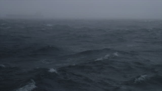 shadow of a cargo boat sailing in a rough sea - nave a vela video stock e b–roll