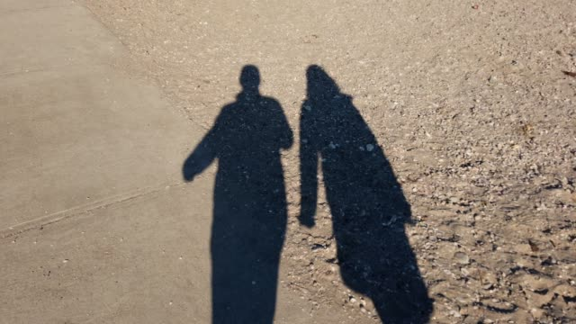 Shadow of a couple on the beach