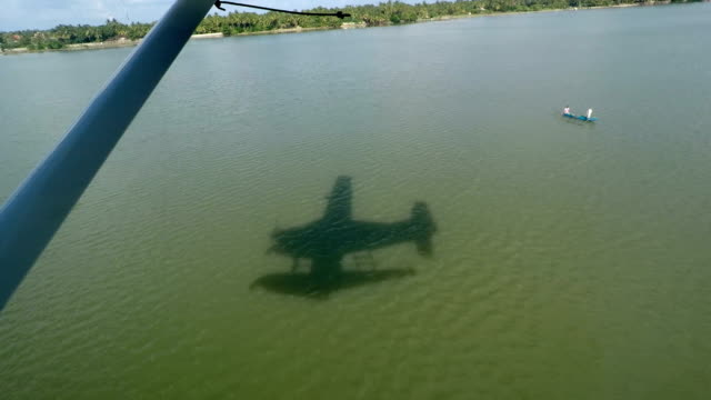 Shadow of a seaplane on the water while landing