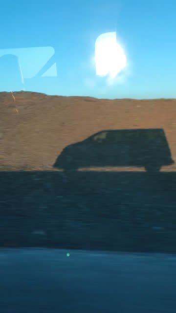 shadow of a van moving over volcanic landscape on iceland - people carrier stock videos & royalty-free footage