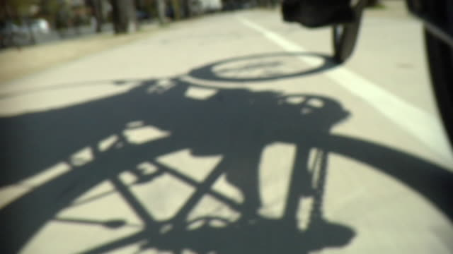 CU Shadow of person riding bike, Paris, France